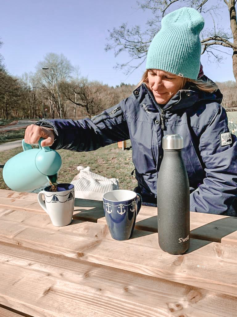 Aga pouring coffee during a picnic